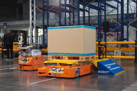 Poznan, Poland 01 Sep 2021: HIGH TECH EXPO. MOBOT AGV mobile robot, warehousing, automatic industrial robot.
