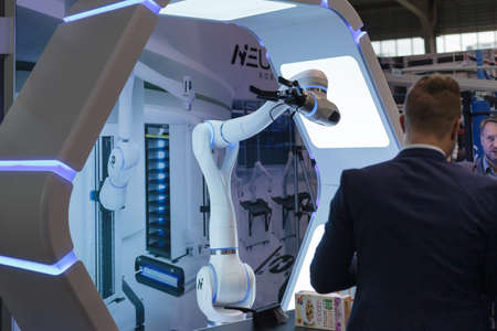 Poznan, Poland 01 Sep 2021: Collaborative robots. Robot arm in technology process, automatic industrial robot. ITM Industry Europe, HIGH TECH EXPO. Editoriali