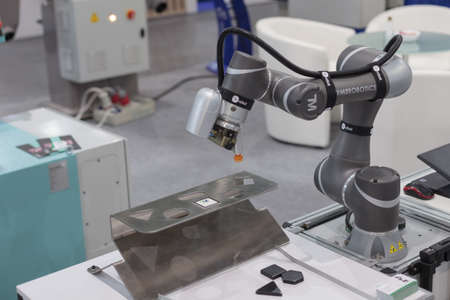 Poznan, Poland 01 Sep 2021: ITM Industry Europe, high-tech EXPO. Robot arm in technology process, automatic industrial robot. TM ROBOT collaborative robots.