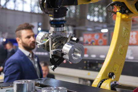 Poznan, Poland 01 Sep 2021: ITM Industry Europe. Robot arm in technology process, automatic industrial robot.