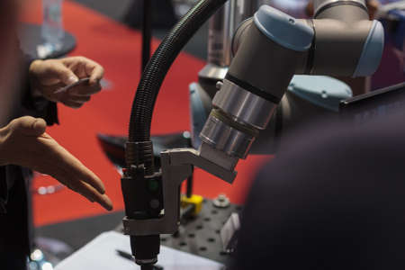 Poznan, Poland 01 Sep 2021: ITM Industry Europe, HIGH TECH EXPO. Items cut using CNC technology, robot.
