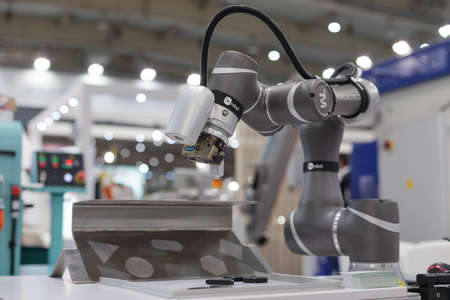 Poznan, Poland 01 Sep 2021: ITM Industry Europe. Robot arm in technology process, automatic industrial robot. TM ROBOT collaborative robots.