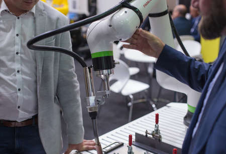 Poznan, Poland 01 Sep 2021: Fanuc robot CRX-10iA, collaborative robots, close-up. Robot arm in technology process, automatic industrial robot. ITM Industry Europe, HIGH TECH-EXPO. Editoriali