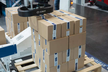 Poznan, Poland 01 Sep 2021: ITM Industry Europe. Robot arm in technology process, automatic industrial robot. Packing and e-commerce. ES COBOT - COLLABORATION ROBOT. Editoriali