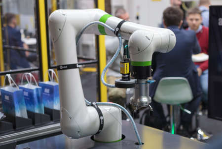 Poznan, Poland 01 Sep 2021: Fanuc robot CRX-10iA collaborative robots. Robot arm in technology process, automatic industrial robot. ITM Industry Europe, HIGH TECH EXPO. Editoriali