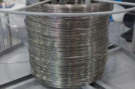 Poznan, Poland 01 Sep 2021: ITM Industry Europe, HIGH TECH EXPO. Items cut using CNC technology, coiled wire, spool.