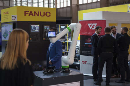 Poznan, Poland 01 Sep 2021: Fanuc robot CRX collaborative robots. Robot arm in technology process, automatic industrial robot. ITM Industry Europe, HIGH TECH EXPO.