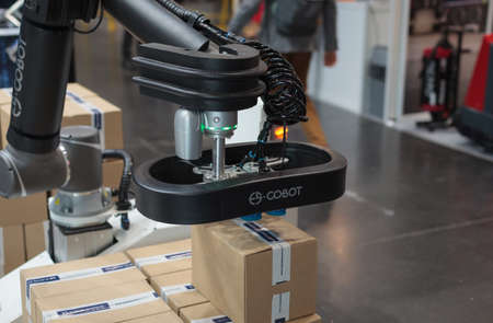 Poznan, Poland 01 Sep 2021: ITM Industry Europe. Robot arm in technology process, automatic industrial robot. ES COBOT - COLLABORATION ROBOT. Packing and e-commerce. Editoriali
