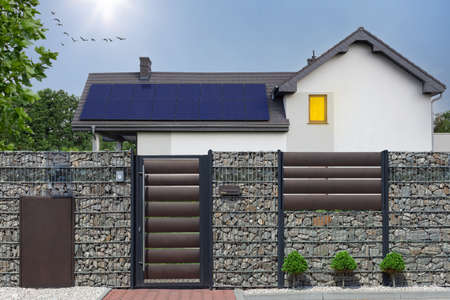 Solar panel installed on the modern house roof. Archivio Fotografico