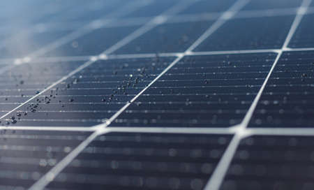 Close-up of dark blue solar panel with water drops. Abstract solar panels texture background. Archivio Fotografico