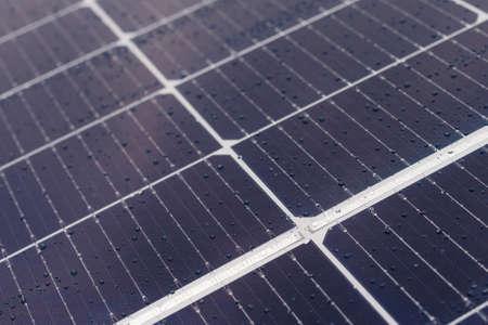 Close-up of dark blue solar panel with water drop. Archivio Fotografico