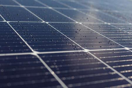 Solar panels blue background, texture. Rain on the solar panel.