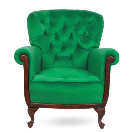 Elegant velor green classic armchair with pillow isolated on white.