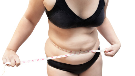 Woman show body fat wearing black underwear bra on white isolated