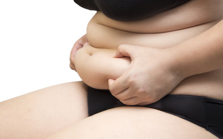 hands on stomach: Woman squeeze belly fat wearing black underwear bra and pant on white isolated