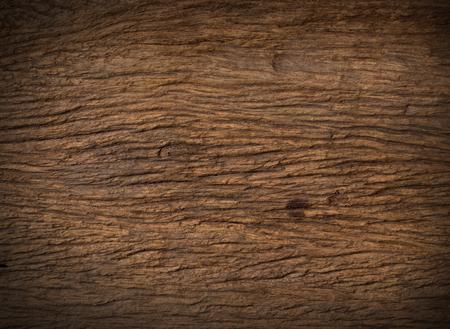 hout natuur donker bruine vlek close-up textuur achtergrond op zwarte achtergrond