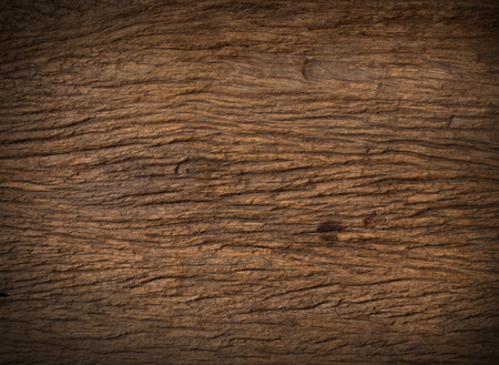 wood nature dark brown stain close up texture background on black background Imagens