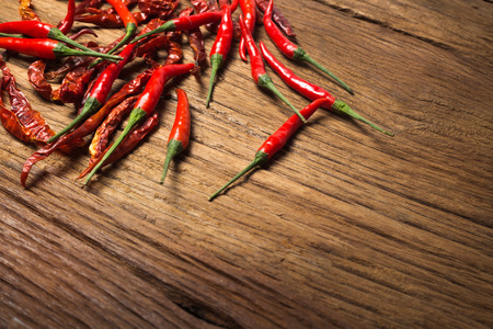 red color: chili on wood texture background Stock Photo