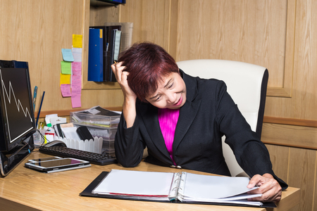bad feeling: stress business woman looking document sheet work problem in office  investment risk stock or business bad feeling great depression