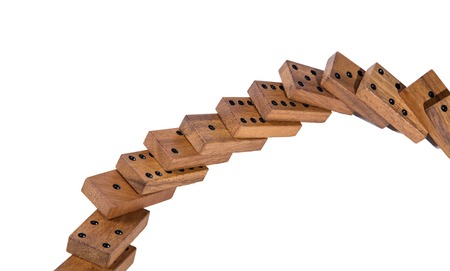 overturn: domino effect falling concept isolated on white