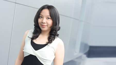 buliding: Young asian business woman smile face on modern buliding background Stock Photo