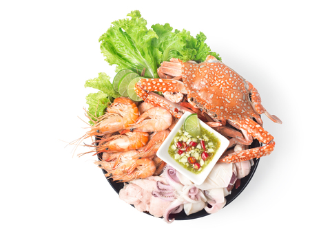 seafood mixed with spicy sauce thai food traditional isolated on white crab shrimp squid and fish in plate Imagens