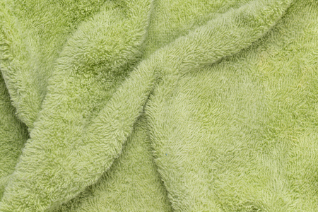 green fabric towel texture background
