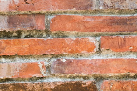 close up bricks wall grunge brown texture background Imagens