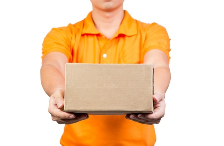 young delivery man holding box cardboard give the package isolated on white background