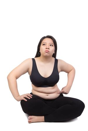 fat woman point finger to belly excess overweight isolated on white background