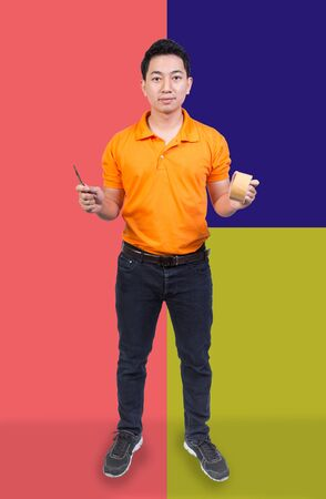 handsome employee man packing service holding cutter and brown tape ready to work face happy smile on pastel color background Imagens