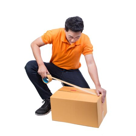 man packing package box with tape isolated on white background Imagens