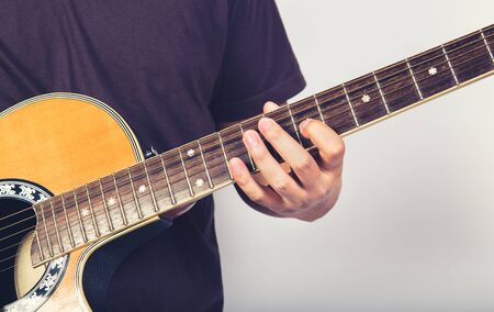 man play acustic guitar on white background close up shot
