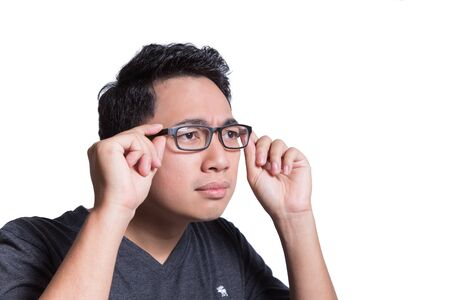 man stare something hand holding glasses to focus eyesight