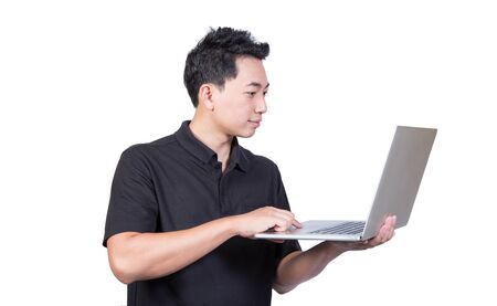 young man holding laptop looking screen and smiling asian smart guy isolated on white background
