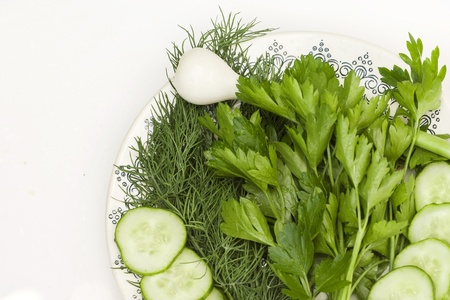 onions: parsley, cucumber and onion in cup Stock Photo