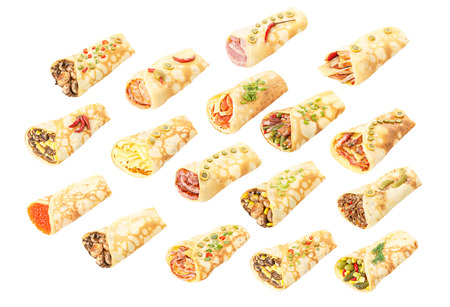 Large collection of elegant,neat, gourmet stuffed crepes decorated with herbs