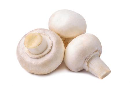 retouched: Three shampignons carefully retouched isolated on white.