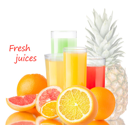 highball: Fresh juices from grapefruit,orange and pineapple in highball glasses near the fruits.