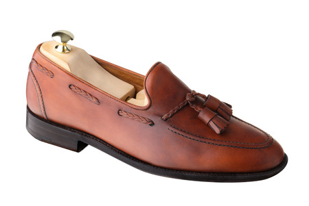 loafer: Almost unworn, single tasseled, handcrafted mens loafer with shoe tree inserted.  The upper is dark leaf calf.