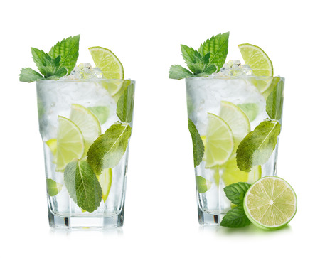 Mojito cocktail in elegant highball glass. Cold refreshing beverage with lime and mint.