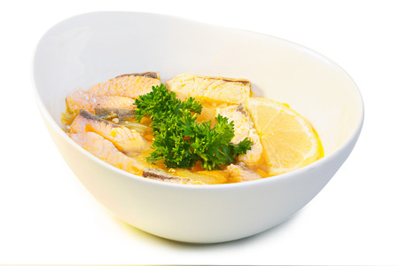 seafood soup: Ear with salmon. Hearty fresh-soup in a bowl isolated on white. Traditional cuisine. Seafood dinner