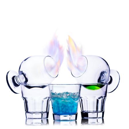 burnished: Burning alcoholic cocktail isolated on white
