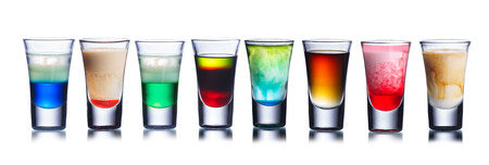 shots: Collection of alcoholic cocktails in shot glasses. Shots. Colorful shot drinks