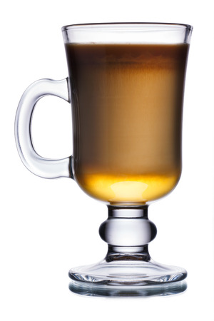 Glass of irish coffee cocktail with irish whiskey