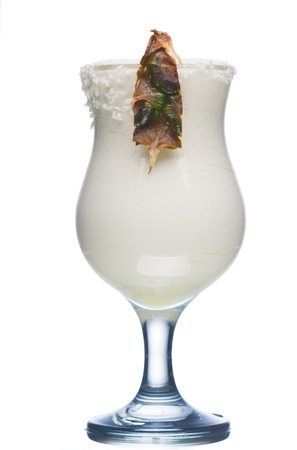 colada: Pina colada alcoholic cocktail in hurrican glass decorated with pineapple slice