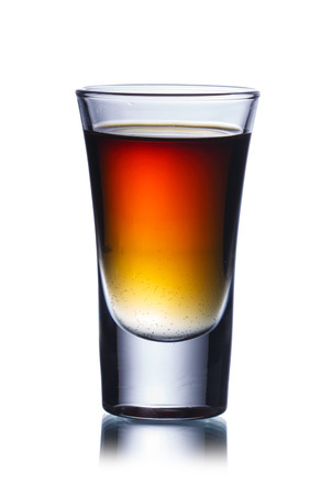 Alcoholic cocktail in shot glass isolated on white