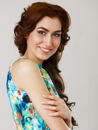 plasticity: Close up portrait of smiling adult female wearing summer dress. Shallow DOF