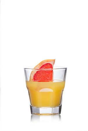 highball: Paradise alcoholic cocktail in highball glass decorated with grapefruit slice Stock Photo