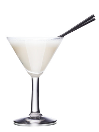 Milk alcoholic cocktail in martinin glass with black straws Zdjęcie Seryjne